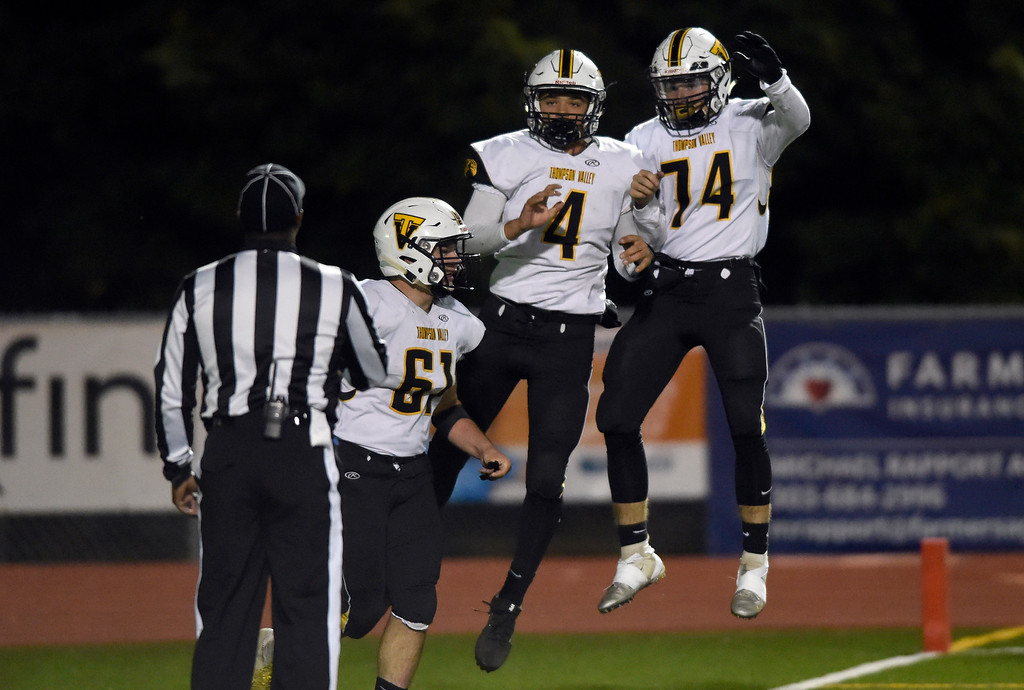 . LONGMONT, CO - OCTOBER 4, 2018: Thompson Valley\'s Cameron Nellor, center, is congratulated on a touchdown by teammates during a game against Niwot on Thursday at Longmont High School. More photos: BoCoPreps.com (Photo by Jeremy Papasso/Staff Photographer)