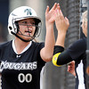 "Niwot High School's Katrina Hunt gets a high-five from a teammate after scoring a run during a game against Wheat Ridge High School on Saturday, Oct. 20, at the Aurora Sports Park in Aurora. Niwot won the game 1-0. For more photos of the game go to  <a href=""http://www.dailycamera.com"">http://www.dailycamera.com</a><br /> Jeremy Papasso/ Camera"