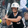 "Niwot High School's Jessica Johnson watches the ball carefully while batting during a game against Wheat Ridge High School on Saturday, Oct. 20, at the Aurora Sports Park in Aurora. Niwot won the game 1-0. For more photos of the game go to  <a href=""http://www.dailycamera.com"">http://www.dailycamera.com</a><br /> Jeremy Papasso/ Camera"
