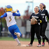 """Niwot High School's Raven Baca, center, and Bailey Kleespies, right, watch as Kelley Junda, No. 3, tries for an extra base during a game against Wheat Ridge High School on Saturday, Oct. 20, at the Aurora Sports Park in Aurora. Niwot won the game 1-0. For more photos of the game go to  <a href=""""http://www.dailycamera.com"""">http://www.dailycamera.com</a><br /> Jeremy Papasso/ Camera"""
