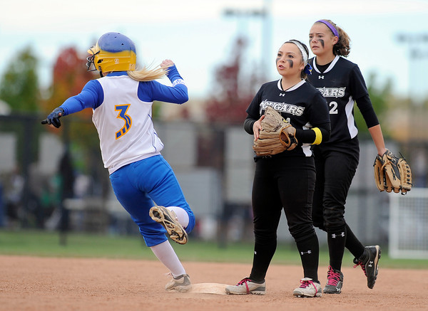 "Niwot High School's Raven Baca, center, and Bailey Kleespies, right, watch as Kelley Junda, No. 3, tries for an extra base during a game against Wheat Ridge High School on Saturday, Oct. 20, at the Aurora Sports Park in Aurora. Niwot won the game 1-0. For more photos of the game go to  <a href=""http://www.dailycamera.com"">http://www.dailycamera.com</a><br /> Jeremy Papasso/ Camera"
