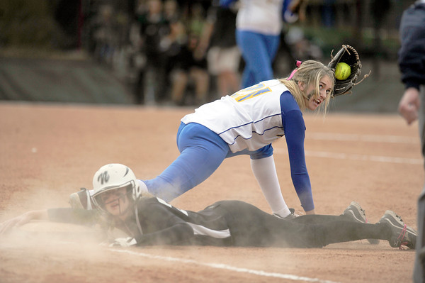 "Niwot High School's Mikalah Artzer slides back to first base safely under Morgan Wilkie during a game against Wheat Ridge High School on Saturday, Oct. 20, at the Aurora Sports Park in Aurora. Niwot won the game 1-0. For more photos of the game go to  <a href=""http://www.dailycamera.com"">http://www.dailycamera.com</a><br /> Jeremy Papasso/ Camera"