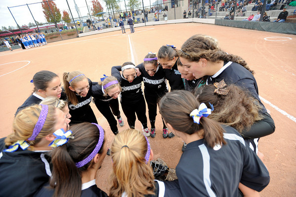 """The Niwot High School varsity girls softball team does a chant at the start of a game against Wheat Ridge High School on Saturday, Oct. 20, at the Aurora Sports Park in Aurora. Niwot won the game 1-0. For more photos of the game go to  <a href=""""http://www.dailycamera.com"""">http://www.dailycamera.com</a><br /> Jeremy Papasso/ Camera"""
