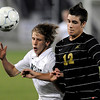 Niwot's Dan Summers (left) bumps Rock Canyon's Matt Morgan (left) while going for the ball during the 4A State Championship soccer game in Commerce City, Colorado November 11, 2009. CAMERA/Mark Leffingwell