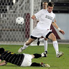 Niwot's Nick Terry leaps over Rock Canyon's Sean Typher during the 4A State Championship soccer game in Commerce City, Colorado November 11, 2009. CAMERA/Mark Leffingwell