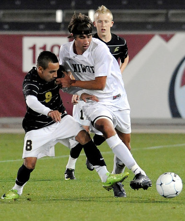 Niwot's Chris Gurule (right) steals the ball from Rock Canyon's Gustavo Hidalgo (left) during the 4A State Championship soccer game in Commerce City, Colorado November 11, 2009. CAMERA/Mark Leffingwell