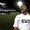 Niwot's Santiago Velez yells in celebration after winning the 4A State Championship soccer game in Commerce City, Colorado November 11, 2009. Velez kicked the game winning goal in overtime. CAMERA/Mark Leffingwell