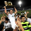 Curtis Stecyk is held up by his teammates while holding the Championship trophy in celebration after winning the 4A State Championship soccer game in Commerce City, Colorado November 11, 2009. CAMERA/Mark Leffingwell