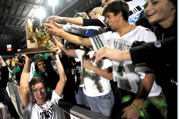 Niwot's Nick Terry holds up the Championship trophy for fans in celebration after winning the 4A State Championship soccer game in Commerce City, Colorado November 11, 2009. CAMERA/Mark Leffingwell