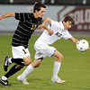 Niwot's Tyler Terry (right) competes for control of the ball with Rock Canyon's Alex Mierau (left) during the 4A State Championship soccer game in Commerce City, Colorado November 11, 2009. CAMERA/Mark Leffingwell