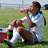 Trying to stay cool Anna Dackus takes a break during the Norman Youth Soccer Striker Keeper camp on Wednesday. Julie Bragg/ The Transcript