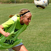 Allison Mayberry heads the ball and tries for a goal at the Norman Youth Soccer Striker Keeper camp on Wednesday. Julie Bragg/ The Transcript.