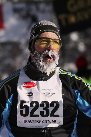 Record-Eagle/Jan-Michael Stump<br /> Karl Trost Sr (5232) finishes the North American VASA with ice on his beard from temperatures that dipped below zero when the race began Saturday at Timber Ridge Resort in East Bay Township.