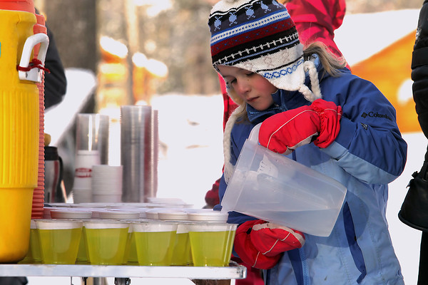 Record-Eagle/Jan-Michael Stump<br /> Camille Rucker, 7, of Traverse City mns the Timber Ridge aid station with family friends during the North American VASA Saturday at Timber Ridge Resort in East Bay Township.