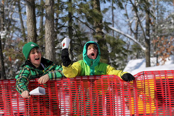 Record-Eagle/Jan-Michael Stump<br /> Andrew Shugart and Alex Grassa both 10, cheer for Alex's dad, Eric Grasso, during the North American VASA Saturday at Timber Ridge Resort in East Bay Township.