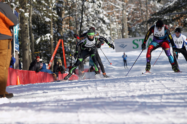Record-Eagle/Jan-Michael Stump<br /> (2502) races (2517) to the finish line in the North American VASA Saturday at Timber Ridge Resort in East Bay Township.