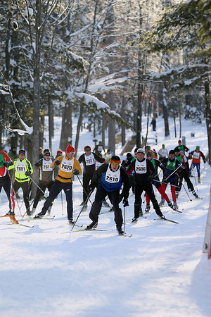 Record-Eagle/Jan-Michael Stump<br /> Competitors approach a corner in Timber Ridge Resort during the North American VASA 27k freestyle race Saturday at Timber Ridge Resort in East Bay Township.