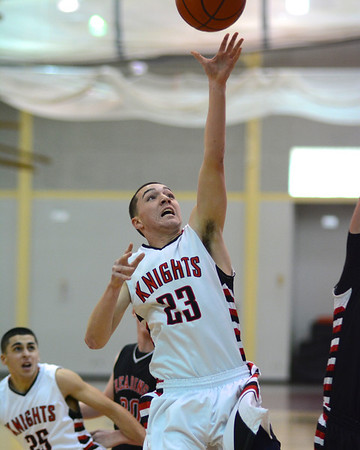 RYAN HUTTON/ Staff photo.<br /> North Andover's John Enright (23) puts the ball up against Reading. North Andover won 58-44.