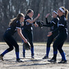 Methuen players from left Kayleigh Forgetta, Nina Correia, Kayla Potter, and Heather McLaughlin celebrate an inning ending double play.