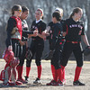 North Andover infielders meet on the mound during a pitching change.