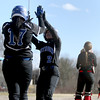 Methuen's Amanda Lemire (2) is congratulated by teammate Kayka Potter after scoring on a hit as North Andover catcher Krya Brown waits for the throw.