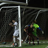 AMY SWEENEY/Staff photo<br /> North Andover's Michael Skarbelis, #13, scores the second goal for the Scarlet Knights while Concord-Carlisle's Scott Brazina tries to help defend the goal with goalie Gabriel Areia. The Knights beat Concord Carlisle 3-1 in the Division 2 final at the Manning Bowl in Lynn last night.
