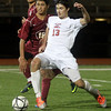 AMY SWEENEY/Staff photo<br /> North Andover's Michael Skarbelis, #13, dribbles the ball up the field against Concord-Carlisle's Leland Kirshen, #18. The Knights beat Concord Carlisle 3-1 in the Division 2 final at the Manning Bowl in Lynn last night.