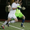 AMY SWEENEY/Staff photo<br /> North Andover's Evan Dudney out runs Concord-Carlisle's goalie Gabriel Areia to score the third goal for the Scarlet Knights, who won the Division 2 final with a score of 3-1 at the Manning Bowl in Lynn last night.