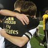 AMY SWEENEY/Staff photo<br /> Connor Boudreau, captain of the Scarlett  Knights, celebrates their win against Concord Carlisle 3-1 in the Division 2 final, with a hug to volunteer assistant coach Martin Graef at the Manning Bowl in Lynn last night.
