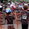 "Lukas Haug, left, and Andrew Vieregg, watch the pro riders fly by in the North Boulder  Park Classic on Saturday.<br /> For more photos of both pro men and women, go to  <a href=""http://www.dailycamera.com"">http://www.dailycamera.com</a><br />  Cliff Grassmick / July 10, 2010"