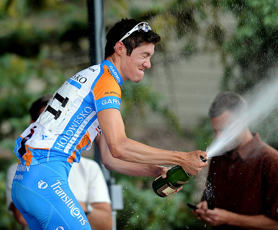 """Alex Howes pops the cork after winning the North Boulder Park Classic pro race on Saturday.<br /> For more photos of both pro men and women, go to  <a href=""""http://www.dailycamera.com"""">http://www.dailycamera.com</a><br />  Cliff Grassmick / July 10, 2010"""