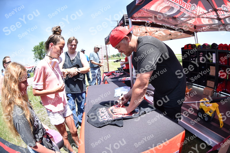 -Messenger photo by Britt Kudla<br /> Ryan Martin autograph a T-shirt for (left) Izabelle Chavez 9, and Jazzmin Chavez 12, of Gowrie  during North Iowa Dragway racing on Saturday in Humboldt