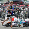A triathlete runs past bicycles in the transition area Saturday. Photo by Pat Christman