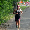 Jenna Rinehart runs away from Hiniker Pond during Saturday's North Mankato Triathlon. Photo by Pat Christman