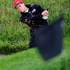 Arthur Kunkel of Durango aims for the flag at hole 17 on Wednesday.<br /> Cliff Grassmick / September 23, 2009