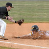 Matt Hamilton/Daily Citizen-News<br /> NM16 tries to stretch a double into a triple but MC3 tags him out.