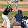 Matt Hamilton/Daily Citizen-News<br /> NM16 fires a pitch against MC10.