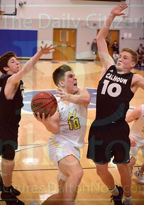 Matt Hamilton/Daily Citizen-News NM10 drives to the hoop between two defenders.