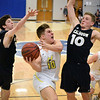 Matt Hamilton/Daily Citizen-News<br /> NM10 drives to the hoop between two defenders.
