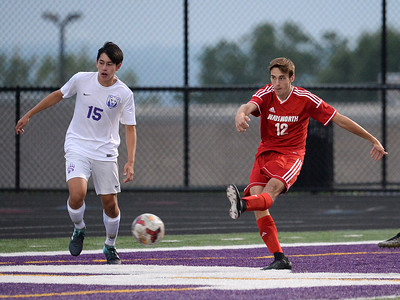Wadsworth's Ben Arnold (12) attempts a goal shot in front of North Royalton's Noah Argana (15) in the first period of Tuesday's game at Serpentini Chevrolet Stadium in North Royalton. (NICK CAMMETT/GAZETTE)