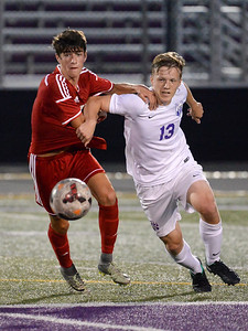 Wadsworth's Matthew Studenic (5) fights with North Royalton's Christopher Emling (13) as they pursue the ball in the first period of Tuesday's game at Serpentini Chevrolet Stadium in North Royalton. (NICK CAMMETT/GAZETTE)