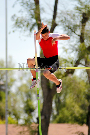 David Jones tosses his pole as he clears the pole vault bar with a personal best