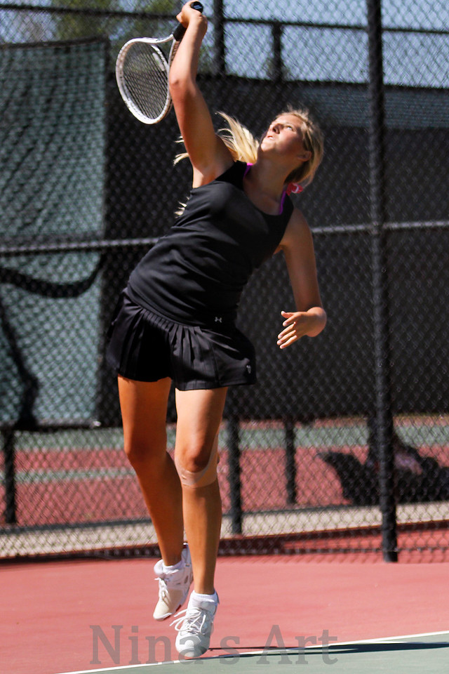Kailey Kaiser serves the ball on her way to a regional championship with teammate Maddie Shelton in #1 doubles tennis