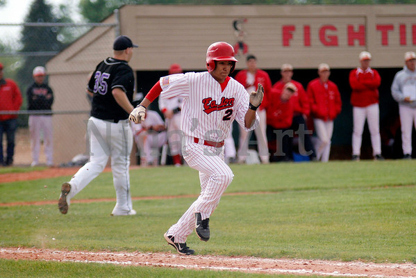 JJ Mondragon sprints to first base safetly in the Reds win over Middle Park