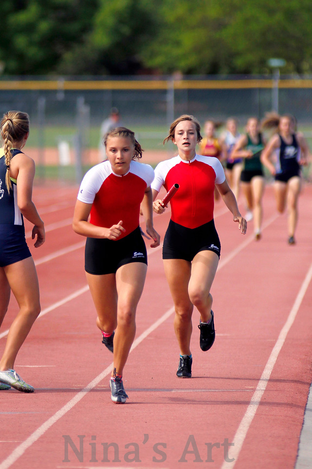 Emily Naill hand the baton to Brittany Pierce in the girls 4 x 200m relay
