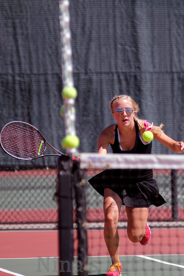 Shelby Edens returns a ball in her regional match   Edens and Kayla Carroll will take their success to the stare tournament in No  2 doubles