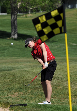"Megan McCambridge of Fairview aims for the flag at hole 9.<br /> The 5A Northern Girls Golf Regional was played at Coal Creek Golf Course in Louisville. <br /> For more photos of the high school golf, go to  <a href=""http://www.dailycamera.com"">http://www.dailycamera.com</a>.<br /> Cliff Grassmick/ May 10, 2011"
