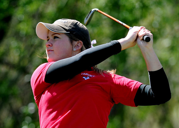 """Amy Carlson of Fairview hits off the 10th tee.<br /> The 5A Northern Girls Golf Regional was played at Coal Creek Golf Course in Louisville. <br /> For more photos of the high school golf, go to  <a href=""""http://www.dailycamera.com"""">http://www.dailycamera.com</a>.<br /> Cliff Grassmick/ May 10, 2011"""