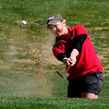"Amy Carlson of Fairview hits out of the sand on hole 9 on Tuesday.<br /> The 5A Northern Girls Golf Regional was played at Coal Creek Golf Course in Louisville. <br /> For more photos of the high school golf, go to  <a href=""http://www.dailycamera.com"">http://www.dailycamera.com</a>.<br /> Cliff Grassmick/ May 10, 2011"