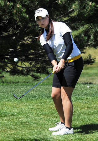 "Gina Larson of Skyline places the ball on the 9th green.<br /> The 5A Northern Girls Golf Regional was played at Coal Creek Golf Course in Louisville. <br /> For more photos of the high school golf, go to  <a href=""http://www.dailycamera.com"">http://www.dailycamera.com</a>.<br /> Cliff Grassmick/ May 10, 2011"